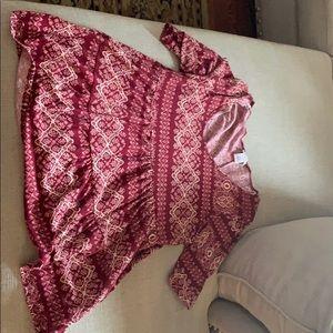 Patterned burgundy Wet Seal blouse.